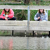 John P. Cleary |  The Herald Bulletin<br /> Kara Hobbs, 17, and Peyten Murdock, 17, try their hand at casting between the railings  as they fish off the pier at Pulaski Park Saturday afternoon.