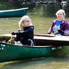Don Knight | The Herald Bulletin<br /> Anderson University students Nicki Kiefer, left, and Heather Krapfl arrive at Edgewater Park with part of a sail boat found in the White River during the  White River Watchers annual fall cleanup on Saturday. Eighty people turned out for the group's 20th fall cleanup.