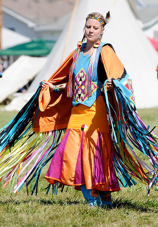 Don Knight | The Herald Bulletin<br /> Kayla Rudd, a member of the Miami Nation of Indiana, dances in her fancy shaw regalia during the Andersontown Powwow on Saturday.