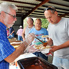John P. Cleary |  The Herald Bulletin<br /> State Senator Tim Lanane, D, District 25, servers up coney sauce for Jim Short, Anderson, at the annual Solidarity Labor Council Labor Day Picnic at Beulah Park Monday.
