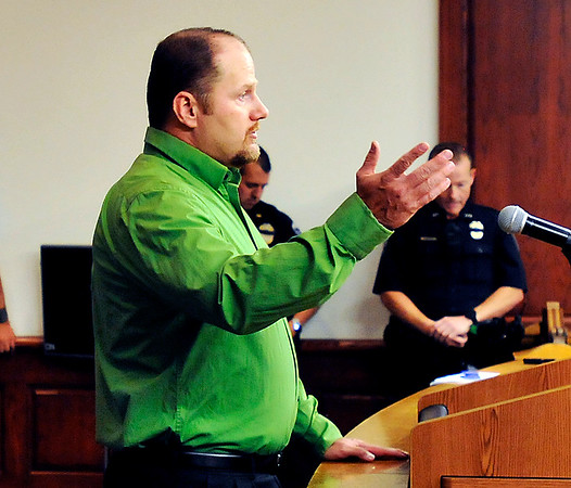John P. Cleary    The Herald Bulletin<br /> Former Elwood Police officer John Davis addresses the Elwood Board of Works Monday and tells them that Chief Jason Brizendine attempted to intimidate him through his new boss.