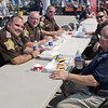 """Madison County police officers Andy Williams, John Owen, David Kolros and Darren Dyer, along with Jeff Ehrhart of the Chesterfield-Union Township Volunteer Fire Department, enjoy lunch at the 2017 """"Honor the Badge"""" event at the Mounds Mall."""