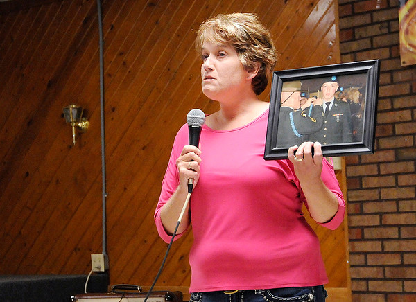 Don Knight | The Herald Bulletin<br /> Mary Randol holds up a photo of her son Dustin who died of an overdose as she shares her story during the International Overdose Awareness Day event at the Anderson Fire Fighters Lodge on Thursday.