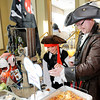 Don Knight | The Herald Bulletin<br /> Rosemary Likens adds a pirate flag to a serving of Eric Scott's Captain Rodney's Dip during the Community Chefs fundraiser at the Anderson Country Club on Saturday. Sixty men from the community served up unique dishes to sample.