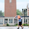 Don Knight | The Herald Bulletin<br /> A trio of students walk under a pair of umbrellas as they cross 5th Street during a light rain on Wednesday. The National Weather Service is forecast an end to the scattered rain today and nice weather for the rest of the week.