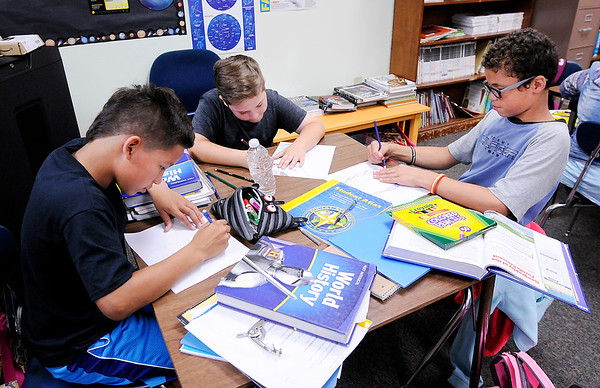 Don Knight   The Herald Bulletin<br /> From left, Anthony Peña, Jagger Sparks and Dorian Hamilton work on a social studies assignment at Daleville Elementary School on Tuesday.