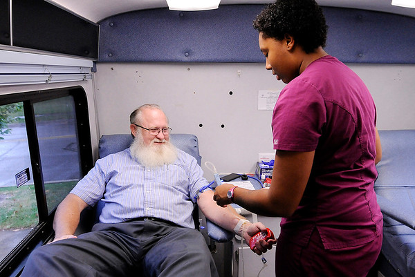 Don Knight | The Herald Bulletin<br /> Phoenix Woods prepares to take a blood donation from Greg Noland as he makes his 100th blood donation on Wednesday. He first gave blood in college because he wanted to know what his blood type was.