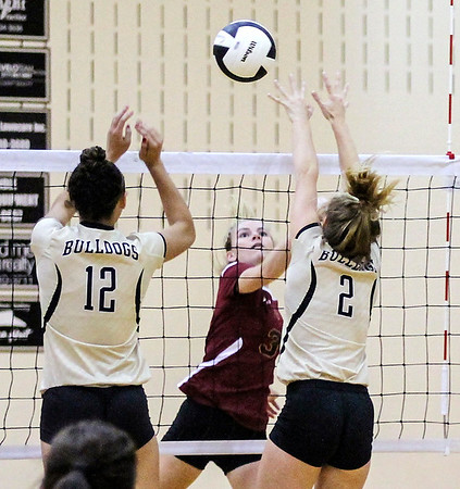 Chris Martin | for The Herald Bulletin<br /> Alexandria's Megan Miller attempts to get a shot past Lapel defenders Isabel Anderson and Makynlee Taylor Thursday night at Lapel.