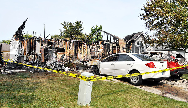John P. Cleary    The Herald Bulletin<br /> House fire that spread to two other homes in the 1400 block of Chesterfield Place.