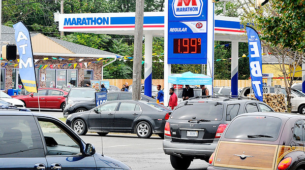 John P. Cleary |  The Herald Bulletin<br /> Traffic was heavy around The Anderson 7 Star convenience store at 19th and Meridian Streets as they held their official grand opening Friday by selling gas for $1.99.9 a gallon.
