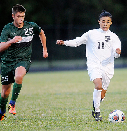 Don Knight | The Herald Bulletin<br /> Anderson's Alan Olguin controls the ball as Pendleton Heights' Nolan Akridge looks to stop him on Wednesday.