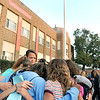 John P. Cleary |  The Herald Bulletin<br /> Students and staff of Liberty Christian High School pray together as they gathered around for the 27th annual Meet Me at the Pole event Wednesday morning.