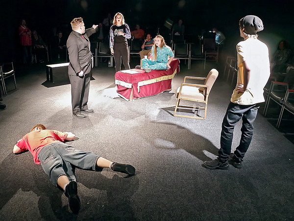 "After striking down Ryder (Darian Lane), Daniel (Cameron Vale) turns his attention to Iris (Lilly Elrod) and Mallory (Madison Brady), while Ashton (Zeke Hensley) looks on in ""The Ouija Board."""
