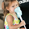 John P. Cleary |  The Herald Bulletin<br /> Arminda Cook, 2, works on eating her cotton candy while attending the annual Solidarity Labor Day Picnic at Beulah Park Monday.