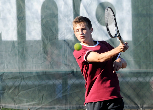 Don Knight | The Herald Bulletin<br /> Alexandria's Sam Hensley returns a volley to Anderson's Austin Mote in the No. 2 singles match during the tennis sectional at Highland on Thursday.