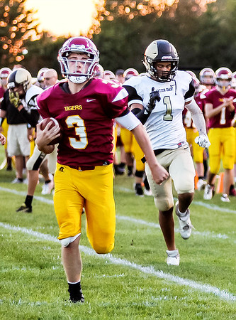 Chris Martin | for The Herald Bulletin<br /> Alexandria's Rylan Metz runs into the endzone Friday night at home against Madison-Grant.
