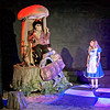 Mark Maynard | for The Herald Bulletin<br /> Alice (Julia Beeler) is rather perplexed by the hookah-smoking Caterpiller (William Malone) she encounters during her journey through Wonderland.