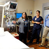 Don Knight | The Herald Bulletin<br /> From left, Director of ICU and Ortho Neuro Cindy Bisser, ICU Clinical Manager Shelby Sloan and Pulminary Critical Care Nurse Practitioner Brad Rector talk about the new intensive care unit at Community Hospital Anderson on Wednesday. Community's new intensive care unit has five more beds than the previous unit and more room for equipment. The unit, which now has a total of 17 beds, has a lift in each room for the protection and ease of patients and staff. A lot of the changes were made to staff areas within the unit, including a centralized medication room, a large, connected nursing station with nursing pods along the hallway and new areas for doctors to talk with families about the plan of care for patients.