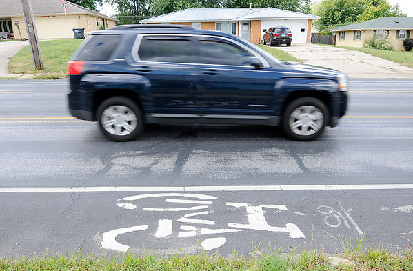 Don Knight | The Herald Bulletin<br /> There are bike lanes on Columbus Avenue between 32nd and 53rd Streets.  According to the city adding bike lanes to 8th St. will cost between $25,000 to $35,000.