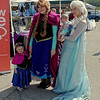 "Wearing her own Anna costume, Cindy Trueblood and her baby sister Mia pose for a photograph with ""Frozen"" characters Anna and Elsa portrayed by Daisy Ray and Ashley Heiney of ""Once Upon a Princess"" at the ""Honor the Badge"" event on Sunday."
