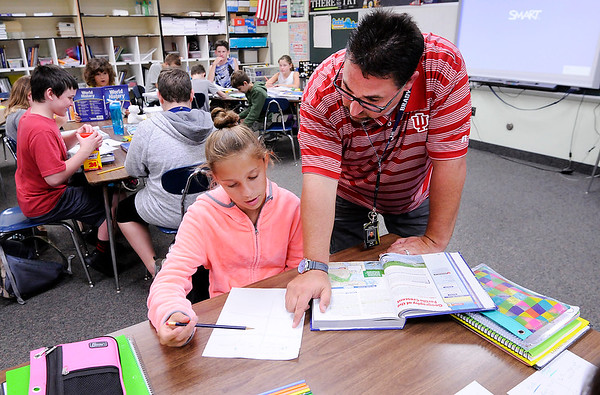 Don Knight | The Herald Bulletin<br /> Social studies and science teacher Jeremy Middleton answers a question for Madison McClellan at Daleville Elementary School on Tuesday.