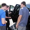 Don Knight | The Herald Bulletin<br /> Ed Martin employee Jacob Flowers, center, talks to Jesse Tomlin, left, and Tilus Zachary about auto body repair during the D26 Auto and Trade Expo on Friday. Flowers is a D26 graduate.