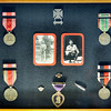 John P. Cleary |  The Herald Bulletin<br /> WWII Army veteran Virgil Stamm recently made the Indy Honor Flight to Washington D.C. This is Virgil's case of combat medals and Purple Heart along with a bullet that hit him during the war but didn't break his skin and landed by his feet.