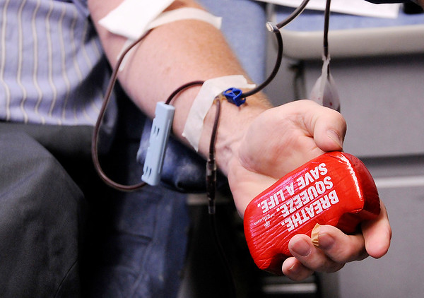 Don Knight | The Herald Bulletin<br /> Greg Noland makes his 100th blood donation on Wednesday. Noland started with the goal of donating 10 gallons, 80 donations.
