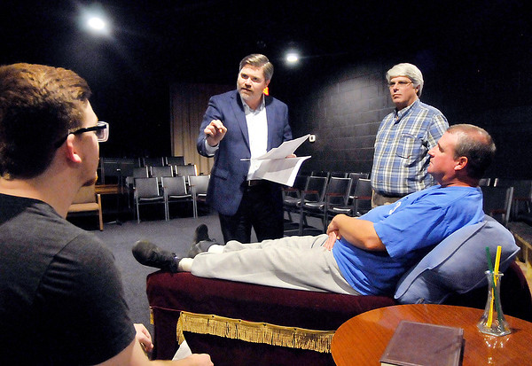 "John P. Cleary |  The Herald Bulletin<br /> Director David Coolidge, second from left, gives instructions to his actors during rehearsals of playwright Jay Wile's, second from right, one-act play ""Amazing Grace"" at the Alley Theatre. Four original one-act plays, written by local people, will be featured at the Alley Theatre this weekend."