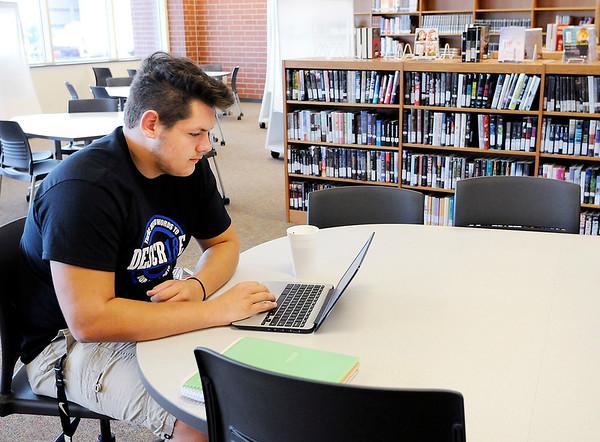 Don Knight   The Herald Bulletin<br /> Justus Kalley studies in the Lapel High School Media Center on Friday.