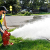 Don Knight | The Herald Bulletin<br /> Kade Hoover with the water department flushes the fire hydrant at 10th and College in Anderson as part of the annual maintenance of the city's hydrants.
