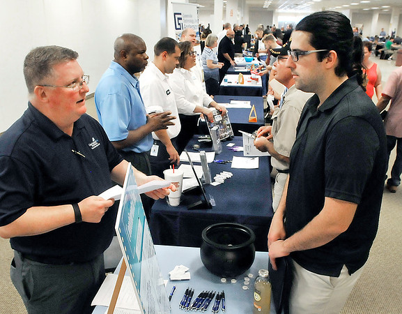 John P. Cleary |  The Herald Bulletin<br /> More then 80 companies gathered at Mounds Mall Thursday for the City of Anderson's HireAnderson Job Fair to talk with people seeking better employment opportunities.