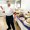 "Don Knight | The Herald Bulletin<br /> Doug Zook auctions an Italian cream cake at Providence Anderson Post Acute during the ""Sweet Memories"" dessert auction on Friday. Proceeds from the auction benefited Providence Arcadia Hall and Alzheimer's walk."