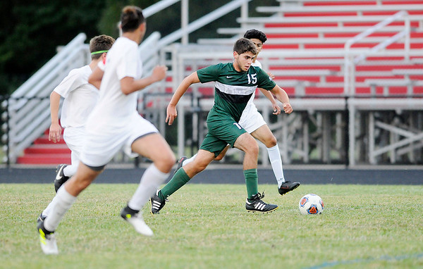 Don Knight | The Herald Bulletin<br /> Pendleton Heights' Mason Fridley controls the ball as the Arabians faced the Anderson Indians on Wednesday.