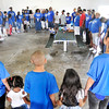 "John P. Cleary |  The Herald Bulletin<br /> Hester family members gather around to pray and bless the food for their ""Family First"" Labor Day get together at Jackson Park Monday."