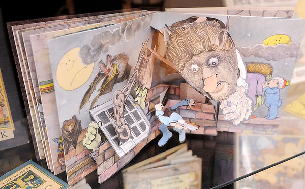 "Don Knight | The Herald Bulletin<br /> The pop up book ""Mommy?"" by Maurice Sendak  is part of a display about the author at the Nicholson Library. Children's authors Jeff Stone, John David Anderson, Louise Borden and Loren Long will be speaking at this year's  Elizabeth York Children's Literature Festival."