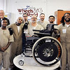 John P. Cleary |  The Herald Bulletin<br /> Pendleton Correctional Industrial Facility's Wheels for the World program. Here members of the program pose for a photo with one of their finished chairs. They are L to R: Back, Dave Tesdal, program coordinator, front, Keayon Scott, Richard Hawkins, Juan Gonzalez, Mark Rowe, Infant Blankenship, Luis Bravo, and Achilles Johnson.