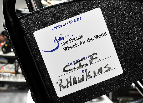 John P. Cleary |  The Herald Bulletin<br /> Each wheelchair rebuilt has this sticker placed on it with the location and name of the person that restored it. Here this chair shows that inmate Richard Hawkins at the Correctional Industrial Facility rebuilt this unit.