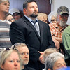 John P. Cleary |  The Herald Bulletin<br /> Elwood Police Chief Jason Brizendine stands in the back of the room during the Board of Works meeting listening to the public comments made about him and his department.