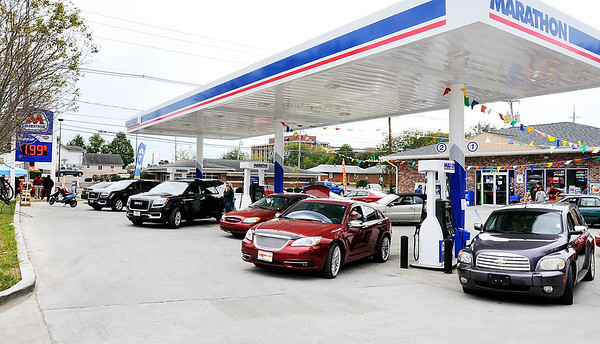 John P. Cleary |  The Herald Bulletin<br /> The Anderson 7 Star convenience store at 19th and Meridian Streets held their official grand opening Friday by selling gas for $1.99.9 a gallon. The line of vehicles was wrapped around the building and down the street.