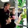 John P. Cleary |  The Herald Bulletin<br /> Tenth Street Elementary School first grade teacher Nicole Dean assists  with students Jackson Hill and Bailey Horning as they work with the hydroponics tower in their classroom this past week.