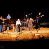 "Don Knight | The Herald Bulletin<br /> Martha Baker joins Cops and Robbers to sing ""Blue Bayou"" during the Little Bit Country Jamboree at the Paramount on Thursday. From left are Rick Copeland, Jeff Hardin, Mark Maynard, Carl Erskine, Jim Jenness, Martha Green, Henry Connelly and Dan Daughtery. This was the 28th year for the Jamboree that is a fundraiser for Madison County Special Olympics."