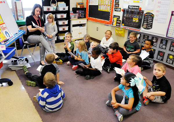 Don Knight | The Herald Bulletin<br /> Students in Michelle Lusher's class share books they have been writing at Killbuck on Tuesday.