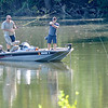 Don Knight | The Herald Bulletin<br /> A pair of Anglers fish at Shadyside on Wednesday. After the soggy start to the week the National Weather Service is forecasting mostly sunny skies and cooler temperatures for the rest of the week.