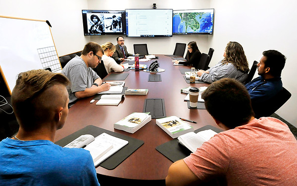 John P. Cleary | The Herald Bulletin<br /> Joel Shrock conducts his class, History of the Vietnam War, in Anderson University's Situation Room.
