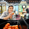 John P. Cleary | The Herald Bulletin<br /> Lorie Hutson picks out fruit items Monday during her visit to the Park Place Community Center Food Pantry.