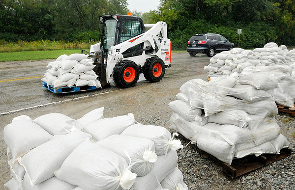Don Knight   The Herald Bulletin<br /> County Highway General Foreman Gerald Imel stages sandbags along Dale Jones Road for use by Madison County residents on Friday.