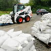 Don Knight | The Herald Bulletin<br /> County Highway General Foreman Gerald Imel stages sandbags along Dale Jones Road for use by Madison County residents on Friday.