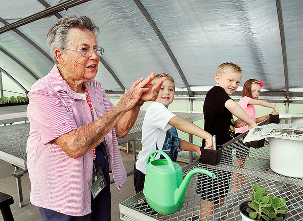 John P. Cleary | The Herald Bulletin<br /> Retired teacher Marilyn Crosley conducts an outdoor gardening program for Pendleton Elementary students. Here Crosley gives instructions to Missy Petro's first grade students on planting their Vicks plant.