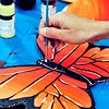 John P. Cleary | The Herald Bulletin<br /> Pastor Kristine Marshall, of Bethel United Methodist Church, puts the finishing details on another of more then 200 butterflies she has painted.